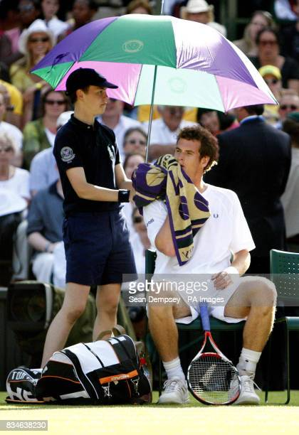 Great Britain's Andy Murray takes a break during his match against France's Richard Gasquet during the Wimbledon Championships 2008 at the All...