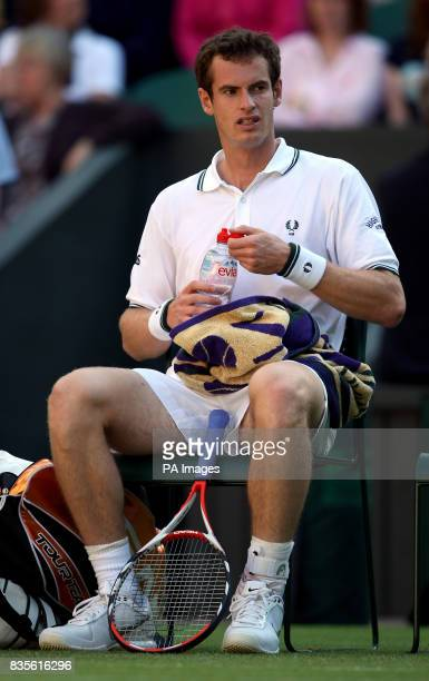 Great Britain's Andy Murray takes a break during his match against USA's Robert Kendrick at the 2009 Wimbledon Championships at the All England Lawn...