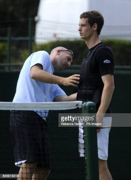 Great Britain's Andy Murray wears a training vest during a practice session during the 2009 Wimbledon Championships at the All England Lawn Tennis...
