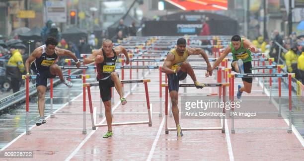 Great Britain's Andy Turner beats Dominic Berger to win the Men's 110m hurdles during the Great City Games Manchester