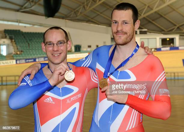 Great Britain's Anthony Kappes and pilot Jon Norfolk with their gold medals after setting a new world record in the 1km tandem final