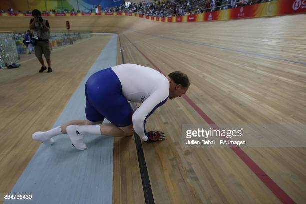 Great Britain's Barney Storey kissing the track after capturing gold in the mens sprint BVI in the Laoshan Velodrome at the Beijing Paralympic Games...