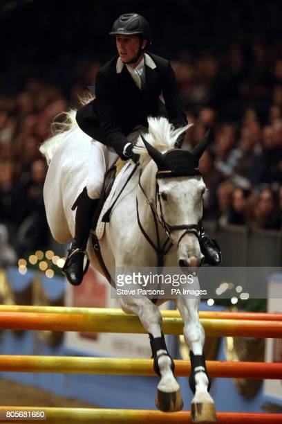 Great Britain's Ben Maher rides Wonderboy III in the Martin Collins Eraser Stakes during the London International Horse Show at the Olympia...