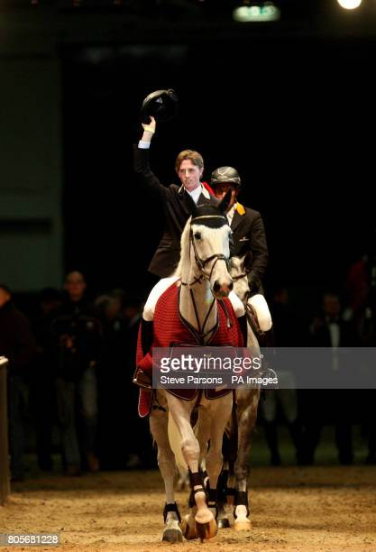Great Britain's Ben Maher riding Wonderboy III salutes the crowd in the Martin Collins Eraser Stakes during the London International Horse Show at...