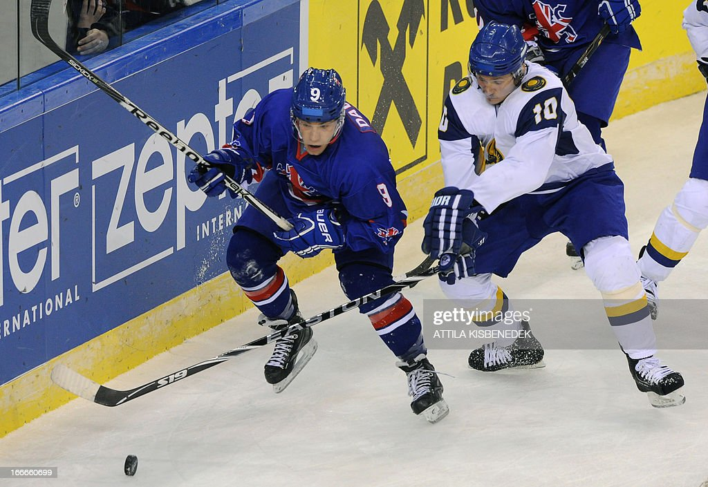 Great Britain's Benjamin Davies (L) vies with Kazakhstan Andrei Spiridonov during a 2013 IIHF Ice Hockey World Championship Division I Group A match between their teams in 'Papp Laszlo' Arena of Budapest on April 15, 2013.