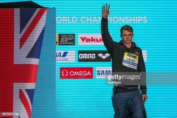 Great Britain's Benjamin Proud celebrates on the podium after the men's 50m butterfly final during the swimming competition at the 2017 FINA World...