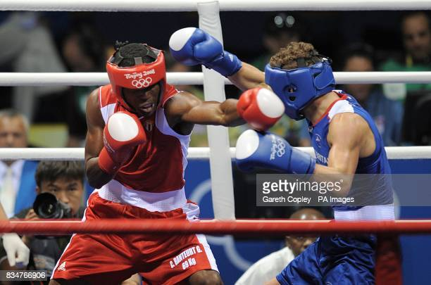 Great Britain's Billy Joe Saunders in action against Cuba's Carlos Banteaux Suarez during their second round Welterweight bout at the Beijing Workers...
