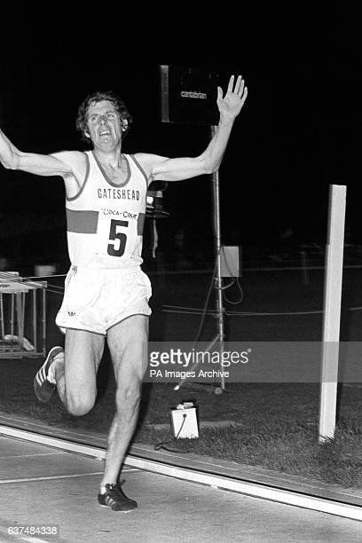 Great Britain's Brendan Foster celebrates winning the Men's 2 miles