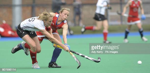Great Britain's Chloe Rogers challenges with Germany's Fanny Rinne during the test match at Bisham Abbey National Sports Centre
