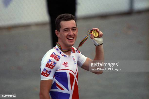 Great Britain's Chris Boardman holds up his gold medal after winning the Men's Individual Pursuit He beat Germany's Jens Lehmann on his new Lotus 108...