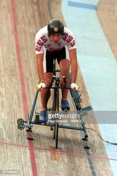 Great Britain's Chris Boardman on his new Lotus 108 bike 'the uniaxle' engineered by Lotus about to start the final race ahead of winning the gold...