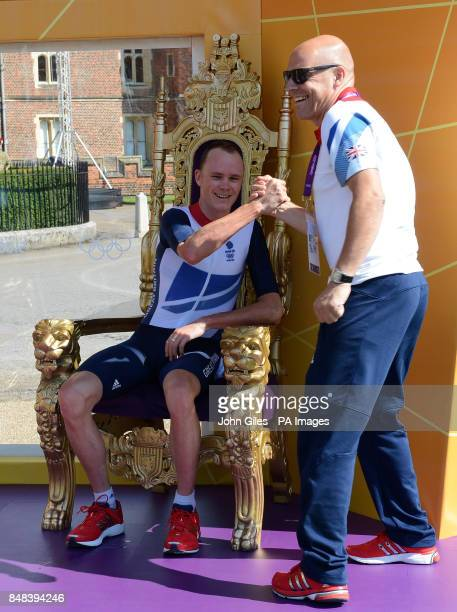 Great Britain's Chris Froome celebrates with British Cycling's Performance Director Dave Brailsford after the Men's Individual Time Trial on day five...
