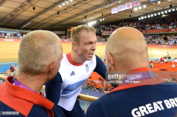 Great Britain's Chris Hoy celebrates with his coach Shane Sutton and David Brailsford after winning Gold in the Men's Team Sprint during day six of...