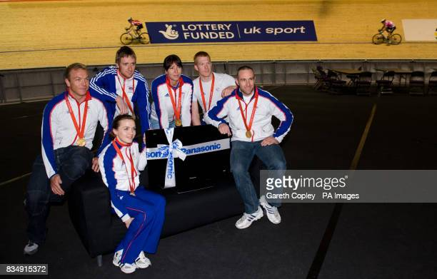Great Britain's Chris Hoy Victoria Pendleton Bradley Wiggins Rebecca Romero Ed Clancy and Jamie Staff pose with a TV they were given by sponsors...
