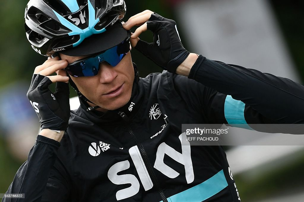 Great Britain's Christopher Froome adjusts his glasses during a training session of cyclists of the Great Britain's Sky cycling team, in Port-en-Bessin-Huppain on July 30, 2016, two days before the start of the 103rd edition of the Tour de France cycling race. The 2016 Tour de France will start on July 2 in the streets of Le Mont-Saint-Michel and ends on July 24, 2016 down the Champs-Elysees in Paris. / AFP / jeff pachoud