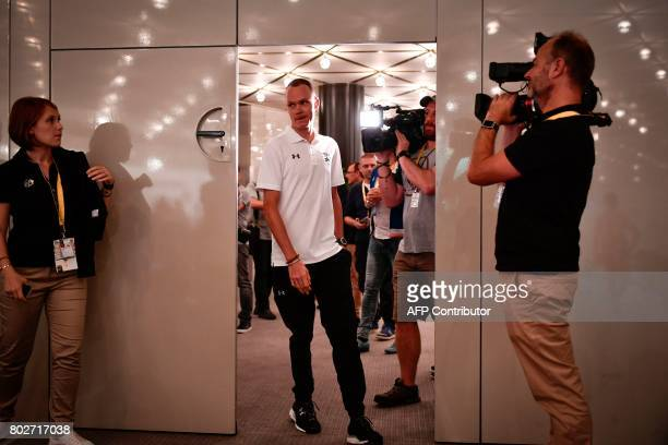 Great Britain's Christopher Froome arrives to take part in a press conference of the Great Britain's Sky cycling team at the Congress center in...
