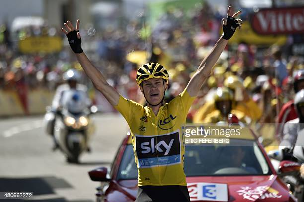 Great Britain's Christopher Froome celebrates as he crosses the finish line at the end of the 167 km tenth stage of the 102nd edition of the Tour de...