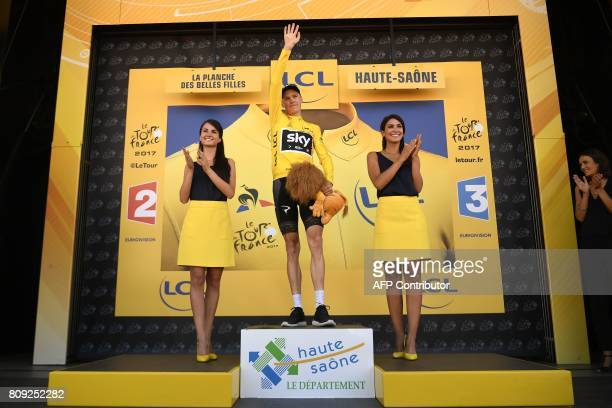 Great Britain's Christopher Froome celebrates his overall leader yellow jersey on the podium at the end of the 1605 km fifth stage of the 104th...