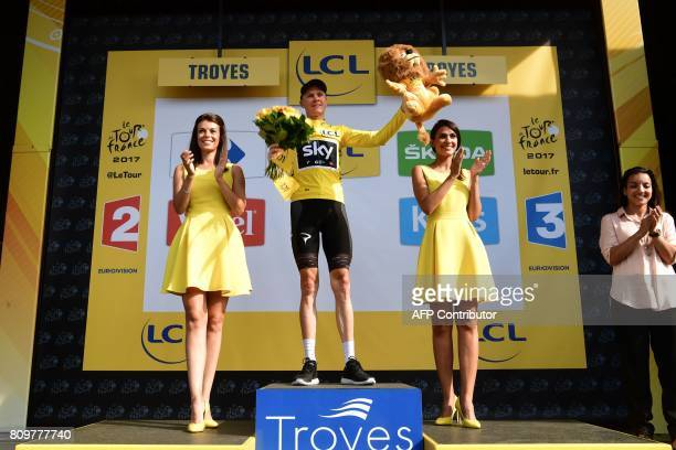 Great Britain's Christopher Froome celebrates his overall leader yellow jersey on the podium at the end of the 216 km sixth stage of the 104th...