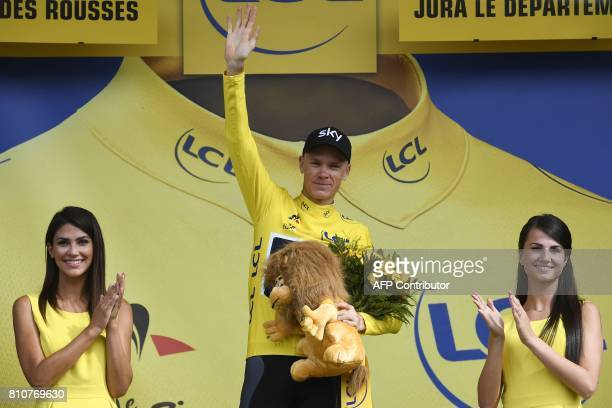 Great Britain's Christopher Froome celebrates his overall leader yellow jersey on the podium at the end of the 1875 km eighth stage of the 104th...