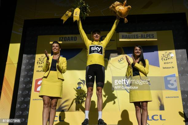 Great Britain's Christopher Froome celebrates his overall leader yellow jersey on the podium at the end of the 1795 km eighteenth stage of the 104th...