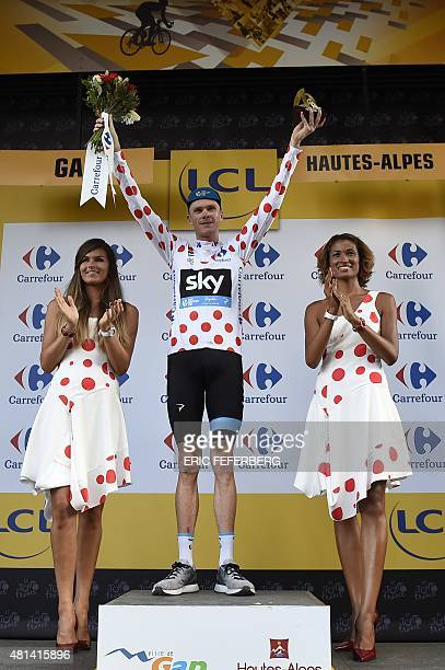 Great Britain's Christopher Froome celebrates his polka dot jersey of best climber on the podium at the end of the 201 km sixteenth stage of the...