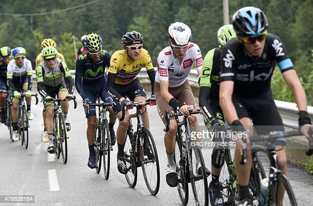 Great Britain's Christopher Froome France's Romain Bardet USA's Tejay Van Garderen wearing the overall leader's yellow jersey ride in the pack during...