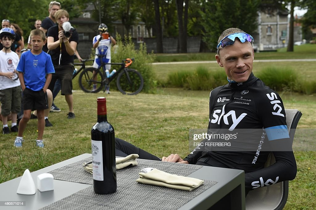 Great Britain's Christopher Froome poses for photographers at his hotel during a rest day as part of the 102nd edition of the Tour de France cycling...