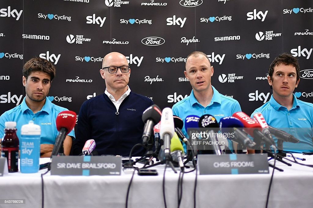 Great Britain's Christopher Froome (2ndR), Sky cycling team manager Sir Dave Brailsford (2ndL), Great Britain's Geraint Thomas (R) and Spain's Mikel Landa take part in a press conference of the Sky cycling team at their hotel in Port-en-Bessin-Huppain, Normandy, on July 30, 2016, two days before the start of the 103rd edition of the Tour de France cycling race. The 2016 Tour de France will start on July 2 in the streets of Le Mont-Saint-Michel and ends on July 24, 2016 down the Champs-Elysees in Paris. The 2016 Tour de France will start on July 2 in the streets of Le Mont-Saint-Michel and ends on July 24, 2016 down the Champs-Elysees in Paris. / AFP / jeff pachoud