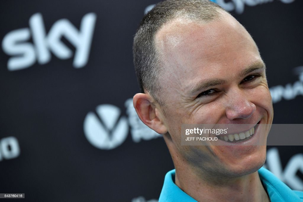 Great Britain's Christopher Froome smiles as he takes part in a press conference of the Sky cycling team at his hotel in Port-en-Bessin-Huppain, Normandy, on July 30, 2016, two days before the start of the 103rd edition of the Tour de France cycling race. The 2016 Tour de France will start on July 2 in the streets of Le Mont-Saint-Michel and ends on July 24, 2016 down the Champs-Elysees in Paris. The 2016 Tour de France will start on July 2 in the streets of Le Mont-Saint-Michel and ends on July24, 2016 down the Champs-Elysees in Paris. / AFP / jeff pachoud