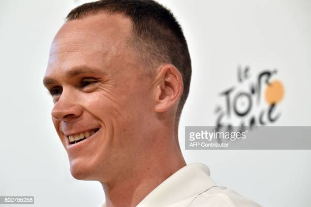 Great Britain's Christopher Froome smiles as he takes part in a press conference of the Great Britain's Sky cycling team at the Congress center in...