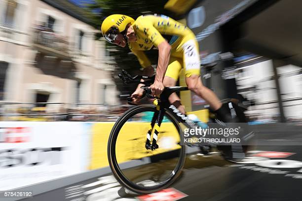 Great Britain's Christopher Froome wearing the overall leader's yellow jersey takes the start of the 375 km individual timetrial the thirteenth stage...