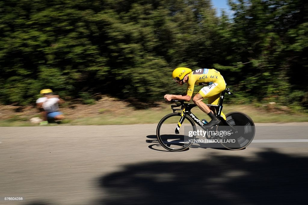 Great Britain's Christopher Froome wearing the overall leader's yellow jersey competes during the 375 km individual timetrial the thirteenth stage of...