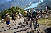 Great Britain's Christopher Froome wearing the overall leader's yellow jersey rides behind Spain's Mikel Nieve and Netherlands' Wouter Poels during...