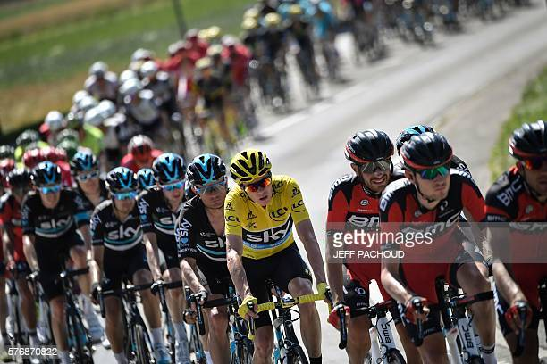Great Britain's Christopher Froome wearing the overall leader's yellow jersey rides in the pack during the 209 km sixteenth stage of the 103rd...