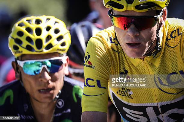 Great Britain's Christopher Froome wearing the overall leader's yellow jersey rides ahead of Colombia's Nairo Quintana during the 1845 km seventeenth...