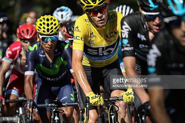 Great Britain's Christopher Froome wearing the overall leader's yellow jersey rides ahead of Colombia's Nairo Quintana and behind Netherlands' Wouter...
