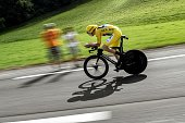 Great Britain's Christopher Froome wearing the overall leader's yellow jersey rides during the 17 km individual timetrial the eighteenth stage of the...