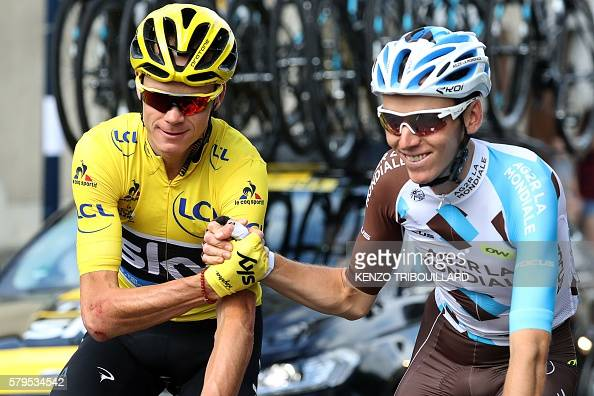 Great Britain's Christopher Froome wearing the overall leader's yellow jersey shakes hands with France's Romain Bardet as they wait prior to the...