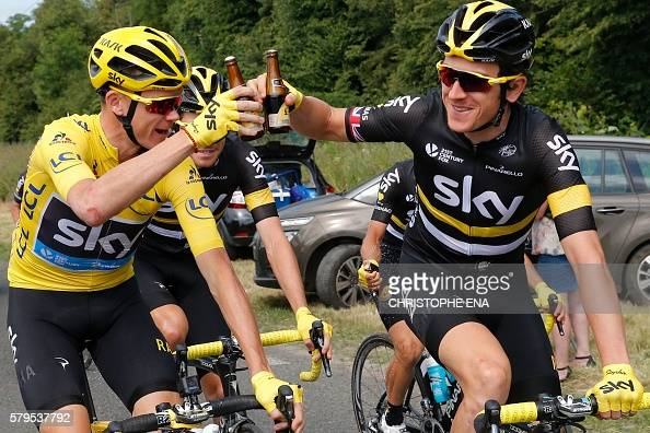 Great Britain's Christopher Froome wearing the overall leader's yellow jersey and Great Britain's Geraint Thomas drink a beer at the start of the 113...