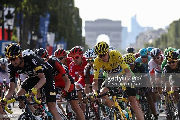 Great Britain's Christopher Froome wearing the overall leader's yellow jersey rides in the pack on the ChampsElysees avenue decorated with French...