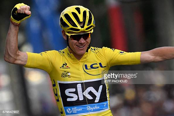 TOPSHOT Great Britain's Christopher Froome wearing the overall leader's yellow jersey wins the Tour de France 2016 as he crosses the finish line on...