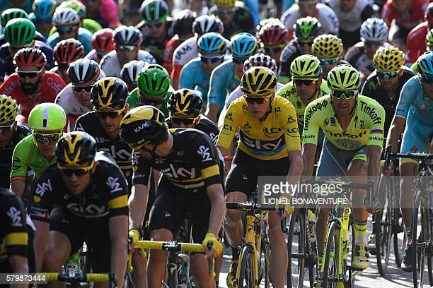 Great Britain's Christopher Froome wearing the overall leader's yellow jersey rides in the pack during the 113 km twentyfirst and last stage of the...