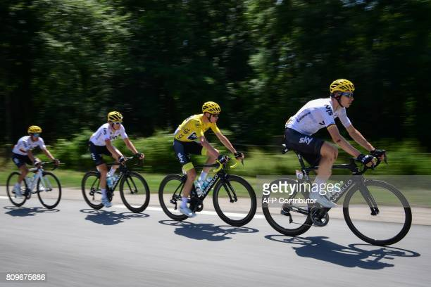 Great Britain's Christopher Froome wearing the overall leader's yellow jersey rides with his teammates of the Great Britain's Sky cycling team...