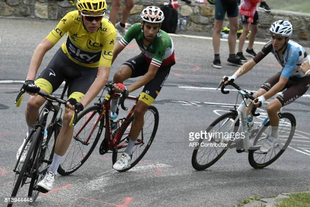 Great Britain's Christopher Froome wearing the overall leader's yellow jersey Italy's Fabio Aru and France's Romain Bardet ride in a breakaway during...