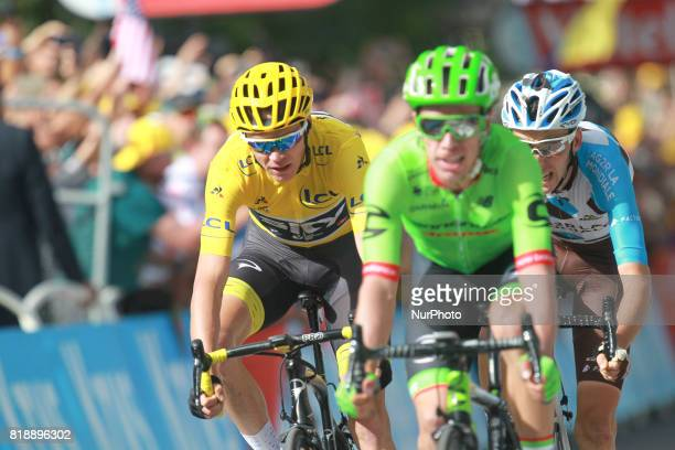 Great Britain's Christopher Froome wearing the overall leader's yellow jersey France's Romain Bardet and Colombia's Rigoberto Uran ride towards the...