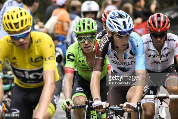 Great Britain's Christopher Froome wearing the overall leader's yellow jersey rides ahead of Colombia's Rigoberto Uran France's Romain Bardet and...