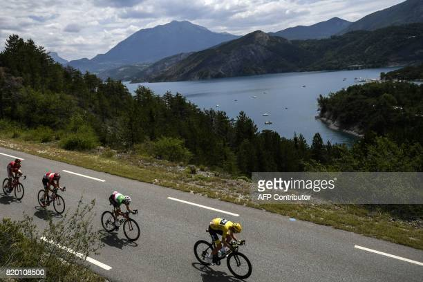 Great Britain's Christopher Froome wearing the overall leader's yellow jersey and Italy's Fabio Aru ride during the 2225 km nineteenth stage of the...