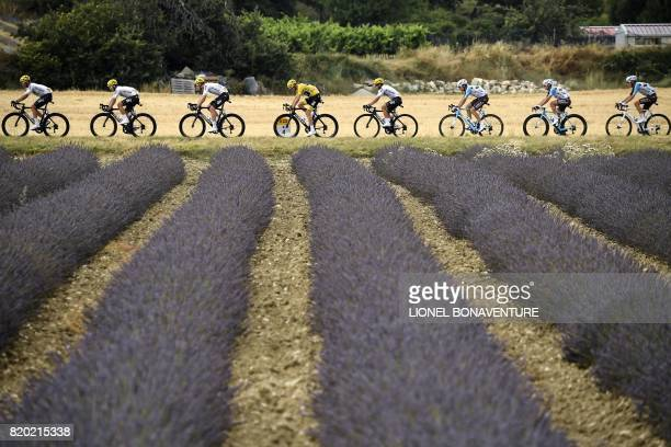 Great Britain's Christopher Froome wearing the overall leader's yellow jersey and France's Romain Bardet ride past a lavander field during the 2225...