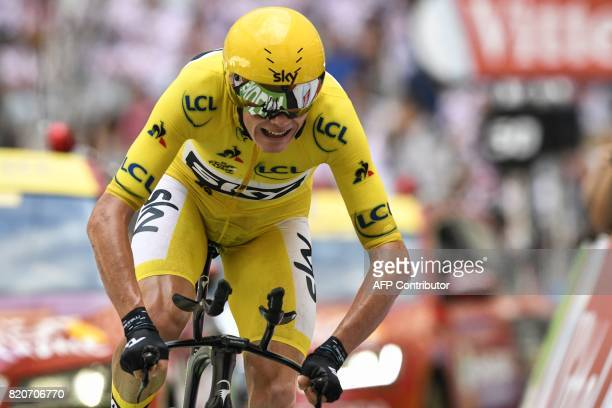 TOPSHOT Great Britain's Christopher Froome wearing the overall leader's yellow jersey crosses the finish line at the Velodrome stadium at the end of...